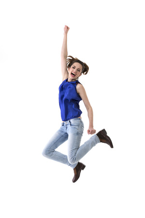 Excited & happy woman jumping for joy. Caucasian ethnicity, isolated on white background.