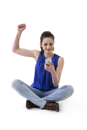 sitted: Happy Woman using a Smart Phone. Isolated over a white background