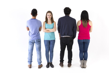 Rear view of friends, one looking back. Isolated on a white background.