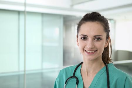 female pose: Female doctor wearing wearing uniform and stethoscope.