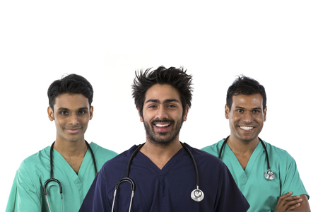 Three Male Indian doctors wearing Scrubs & stethoscope. Isolated on white background. photo