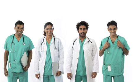 Indian medical team standing. Isolated on white background. photo