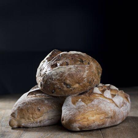artisan bakery: Rustic bread loaf on Black Slate Board.