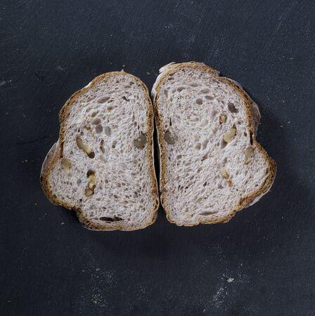 slate board: sliced bread loaf on Black Slate Board.