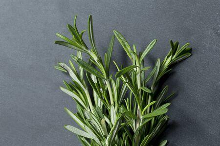 dark grey slate: Bunch of Rosemary sitting on black slate.
