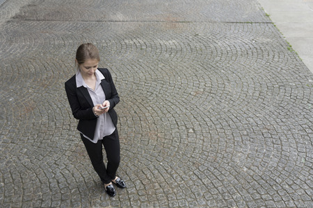 elevated view: Elevated view of a Businesswoman using her smart phone
