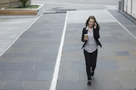 Elevated view of a Businesswoman using her smart phone