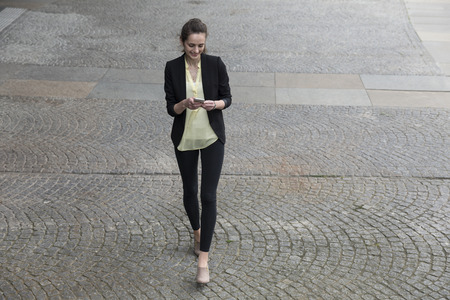 elevated: Elevated view of a Businesswoman using her smart phone