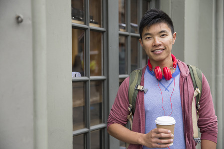 asian natural: Portrait of a trendy urban Chinese man. Urban man in street. Stock Photo