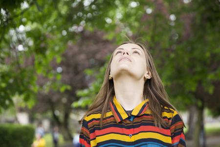woman looking: Portrait of a woman looking up abover her. Stock Photo