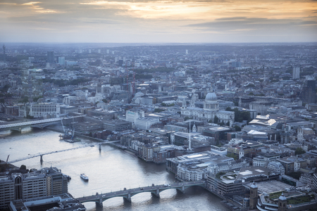 forground: Aerial view of the city of London at dusk. With the River Thames, St. Pauls cathedral and financial district in the forground.