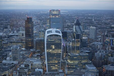 districts: Aerial view of the city of London at dusk. With the financial district in the forground. Stock Photo