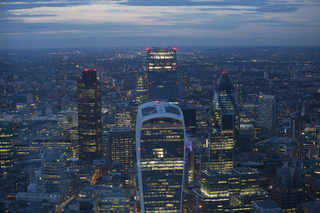 central bank: Aerial view of the city of London at dusk. With the financial district in the forground. Stock Photo