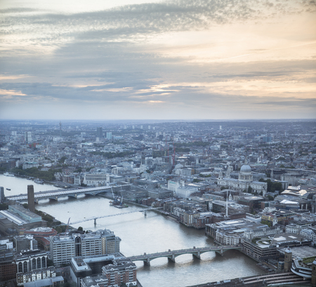 st pauls cathedral: Aerial view of the city of London at dusk. With the River Thames, St. Pauls cathedral and financial district in the forground.