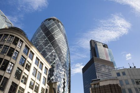 tall buildings: View looking up at the modern office buildings in the City of London. Stock Photo