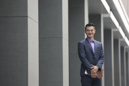 asian business man: Asian business man in modern Asian city.
