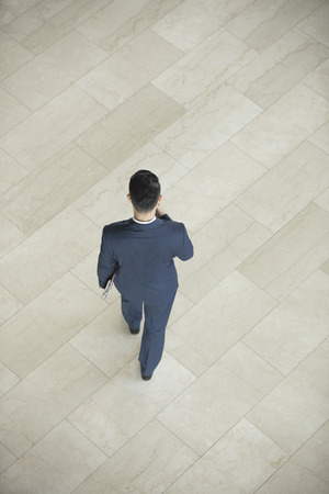 above 30: High angle view of an Asian businessman walking away. Stock Photo