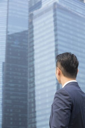 rear view: Rear view of an Asian businessman looking away. Stock Photo
