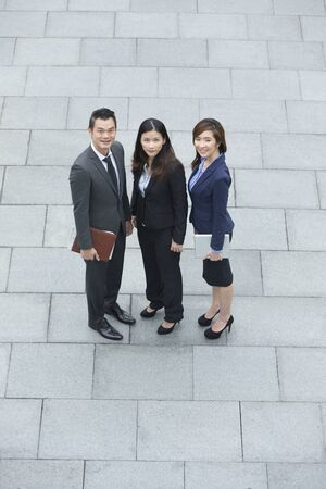 businessman suit: Elevated view of three Chinese Business colleagues. Group of 3 Asian business men and women. Stock Photo
