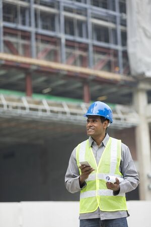 construction site: Portrait of a male Indian industrial engineer or builder at work. Stock Photo
