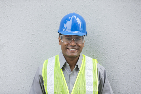 man working: Portrait of a male Indian industrial engineer or builder at work. Stock Photo