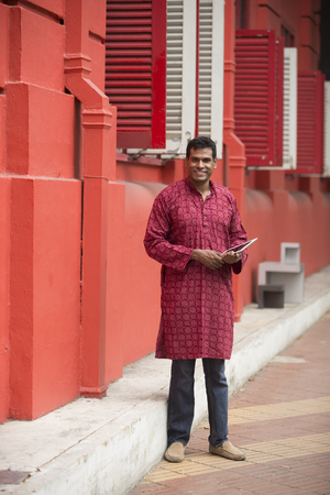kurta: Happy indian man outdoors. portrait of an indian man wearing a Traditional kurta.