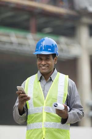 taskmaster: Portrait of a male Indian industrial engineer or builder at work. Stock Photo