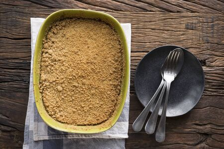 apple crumble: Apple Crumble Dessert. Homemade Apple Crumble pudding sitting on a rustic wooden table. Stock Photo
