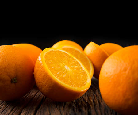 yummy: A bunc of oranges sitting on a rustic wooden table. Stock Photo