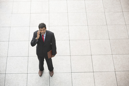 elevated: Elevated view of an Indian businessman using his Smart phone. Stock Photo