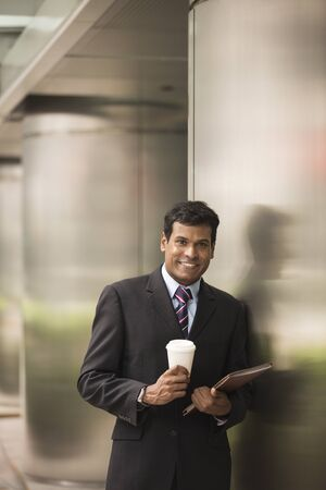 asian business man: Indian business man with a tablet computer. Asian business man using digital tablet computer. Stock Photo