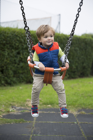 developmental: Young Happy boy having fun at playground. Stock Photo