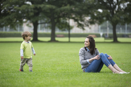 mother love: Happy Mother playing with her toddler son outdoors. Love and togetherness concept. Stock Photo