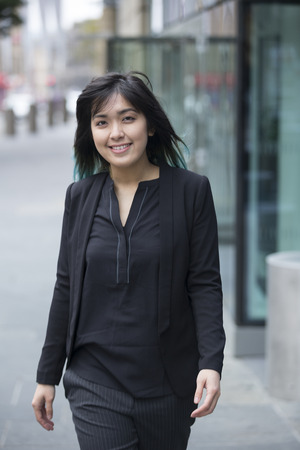 asian businesswoman: Portrait of a beautiful Chinese businesswoman in smart business suit. Asian business woman standing outside in modern city.