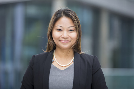 Portrait of a beautiful Filipino businesswoman in smart business suit. Asian business woman standing outside in modern city.