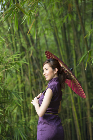 chinese dress: Chinese Woman wearing a Cheongsam Chinese Dress with traditional umbrella.