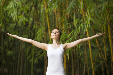 tropical garden: Young Asian woman practicing yoga in a garden. healthy lifestyle and relaxation
