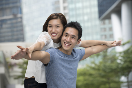 Portrait of a loving Asian couple enjoying themselves on a date. Stock Photo