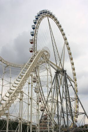 Roller coaster and Ferris wheel photo