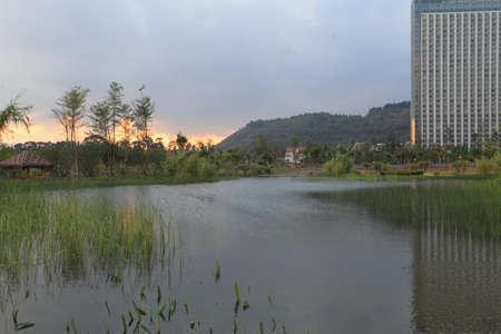 rural development: Buildings beside the pond Stock Photo