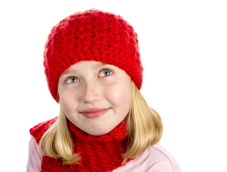 picknick: a cute girl wearing a red knit winter hat and a red knit scarf. portrait isolated on a white background.