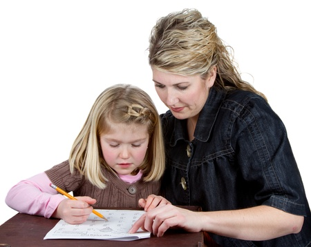 a teacher or maom helping a student or child with homework. pointing at math homework while child works on problem. isolated on a white background Stock Photo