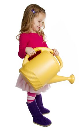 small girl holding a watering can
