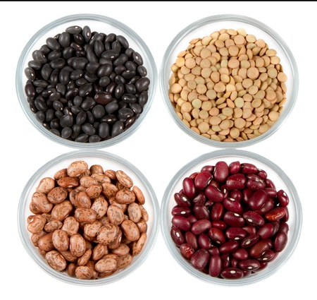 pinto beans: black beans, red beans, pinto beans and lentils photographed in round jars isolated on a white background