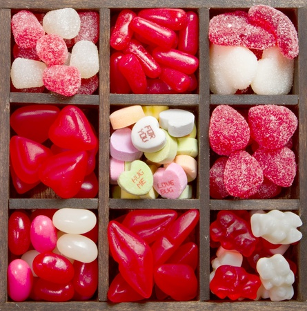 heart shaped: Valentine and heart shaped candy in arranged in a printers box. Stock Photo