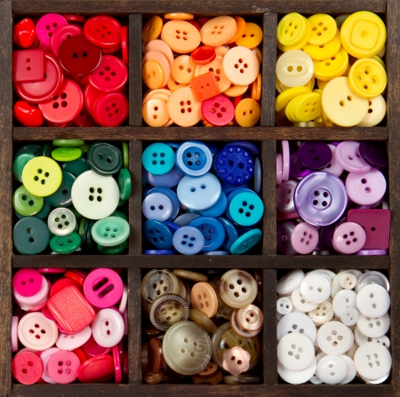 sewing pattern: an assortment of buttons in a rainbow of colors, in a printers box