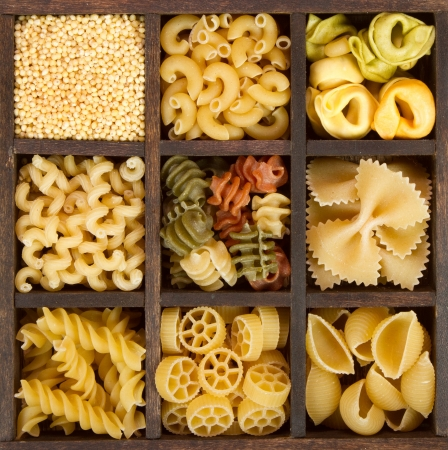 an assortment of italian pasta, nine different varieties separated in a decorative box Stock Photo