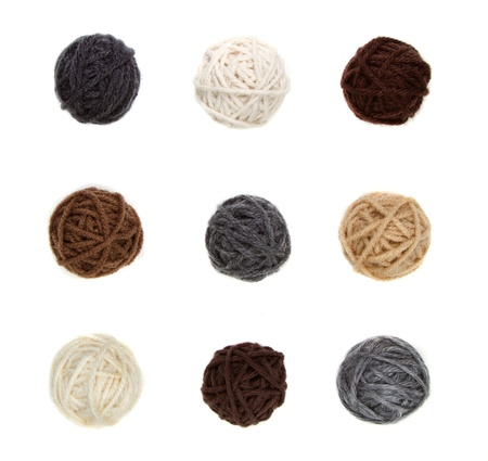 clew: Nine different balls of yarn in neutral colors isolated on a white background Stock Photo