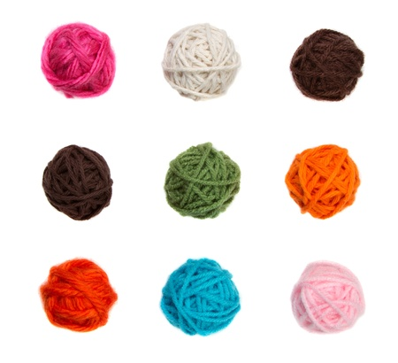 yellow fleece: Colorful balls of yarn in nine different colors isolated on a white background