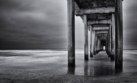 unusually: La Jolla beach, California,  long exposure under the pylons, black and white image. Stock Photo